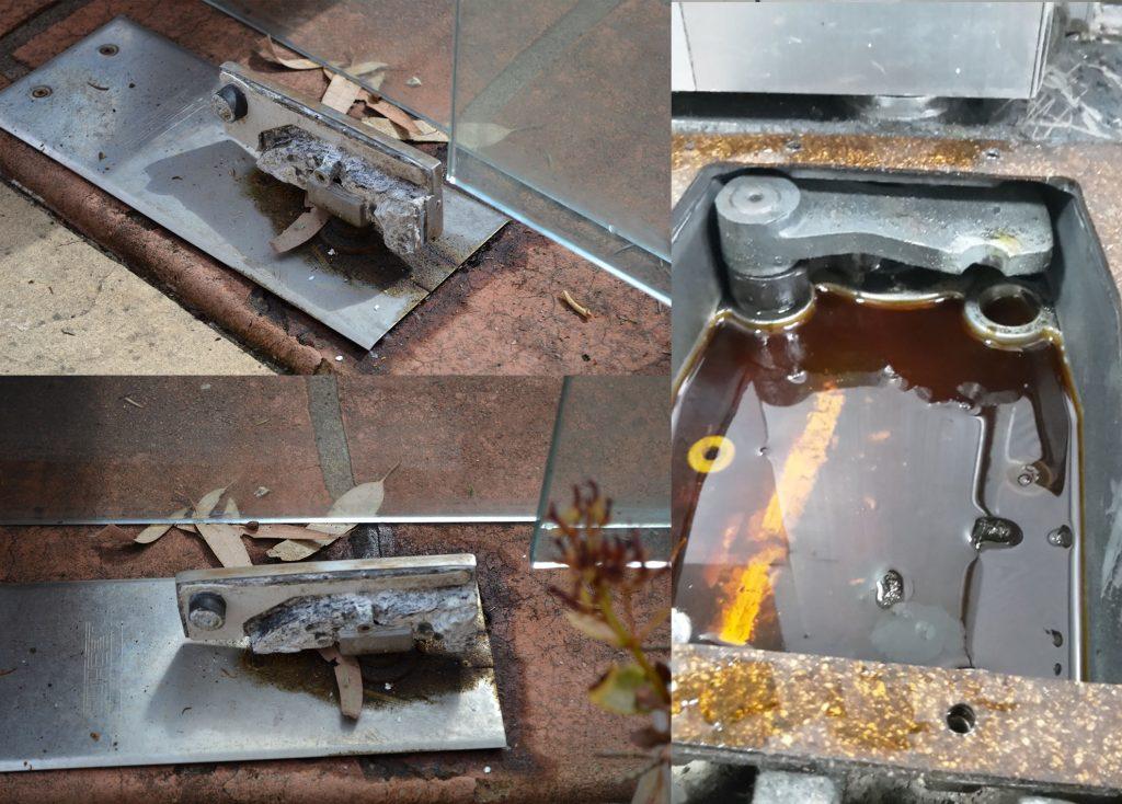 Bản lề sàn cửa kính thủy lực bị chảy dầu